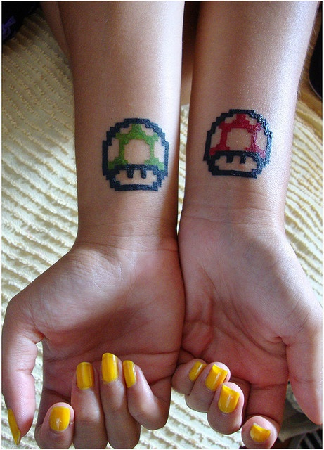 Green and red mario style tattoo