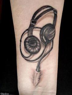 Headphones plugged into wrist tattoo