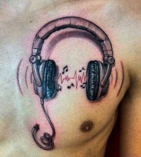Headphones tattoo on breast