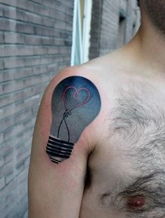 Heart in a lightbulb tattoo