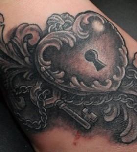 Heart locket and key tattoo
