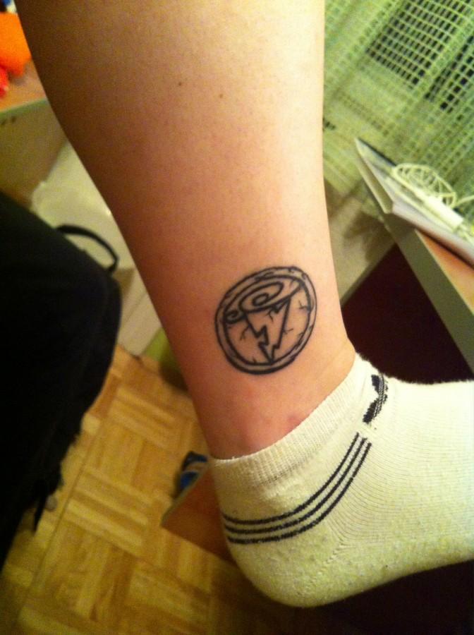 Hercules symbol leg tattoo