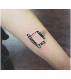 Hot coffee cup tattoo on arm