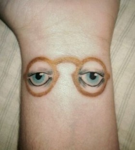 Incredible glass and eye tattoo