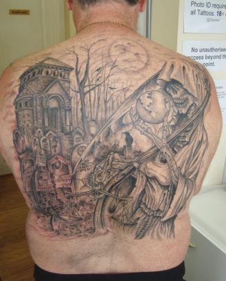 Large graveyard back tattoo