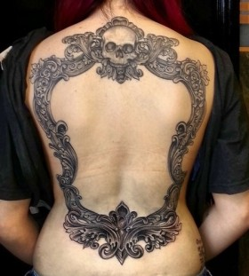Large mirror with a skull back tattoo