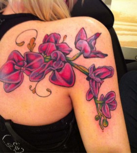 Large orchid shoulder tattoo