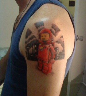 Lego spaceman tattoo on arm