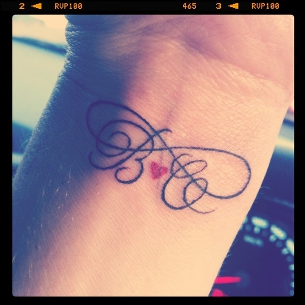 Letters and small heart infinity tattoo