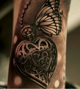 Locket and butterfly arm tattoo