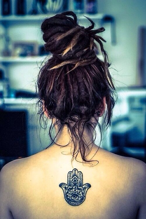 Lovely indie style back tattoo