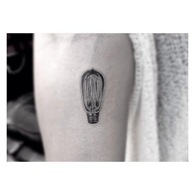 Minimalistic lightbulb tattoo