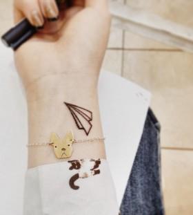 Minimalistic paper plane tattoo
