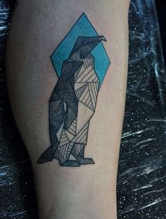 Origami penguin tattoo
