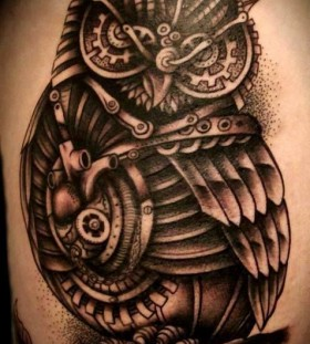 Ornamentally gorgeous black owl tattoo