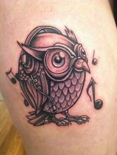 Owl with headphones tattoo