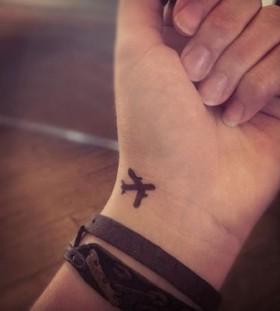 Plane black wrist tattoo