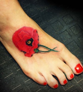 Poppy flower foot tattoo
