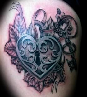 Pretty heart locket and key tattoo
