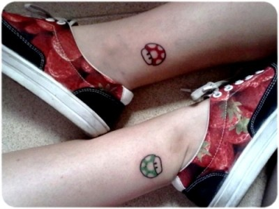 Pretty legs mario style tattoo