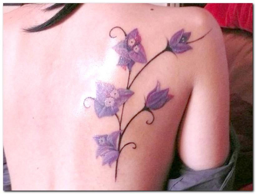 Pretty purple orchid back tattoo