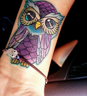Purple and blue owl tattoo