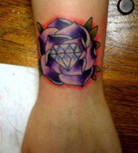 Purple style diamond tattoo on arm