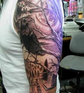 Raven and graveyard sleeve tattoo