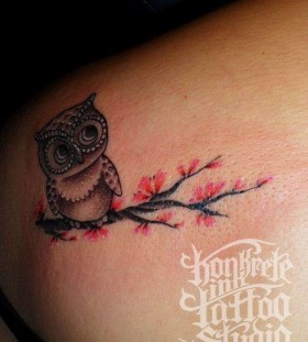 Red blossom tree and owl tattoo