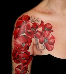 Red poppy flower shoulder tattoo