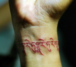 Red wrist Tara Mantra tattoos