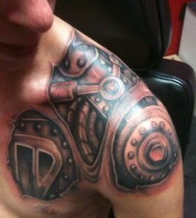 Robot chest and shoulder tattoo