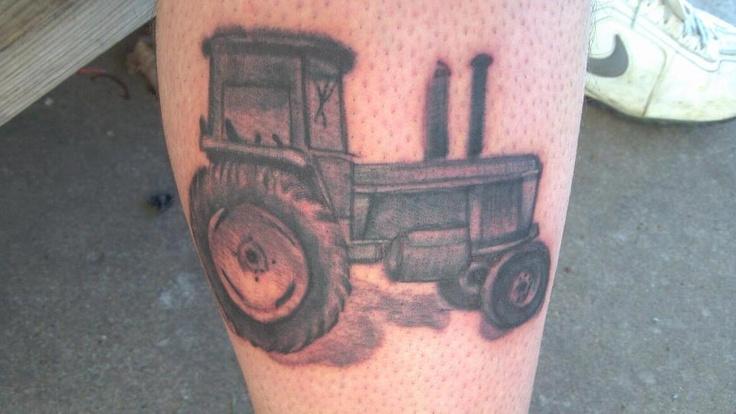 SImple black tractor tattoo
