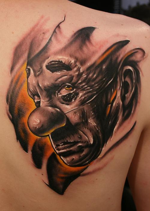 Sad clown back tattoo