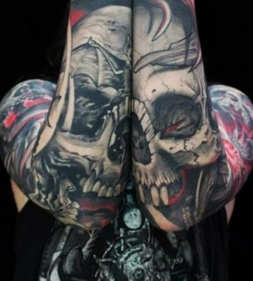 Scary both arm skull tattoo