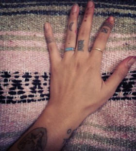 Simple Indie finger tattoos