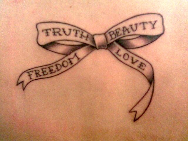 Simple bohemian ribbon tattoo