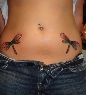 Simple dragon-fly hip tattoos