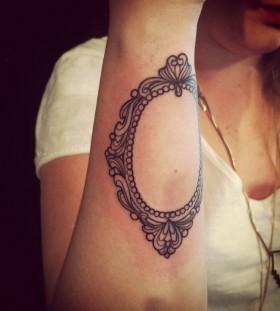 Simple mirror arm tattoo