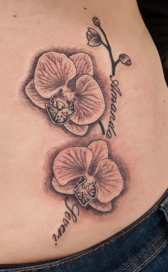 Simple orchid hip tattoo