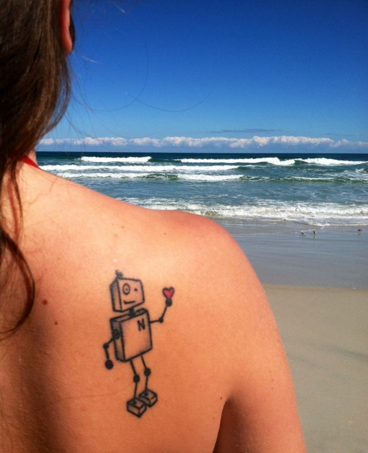 Simple robot back tattoo