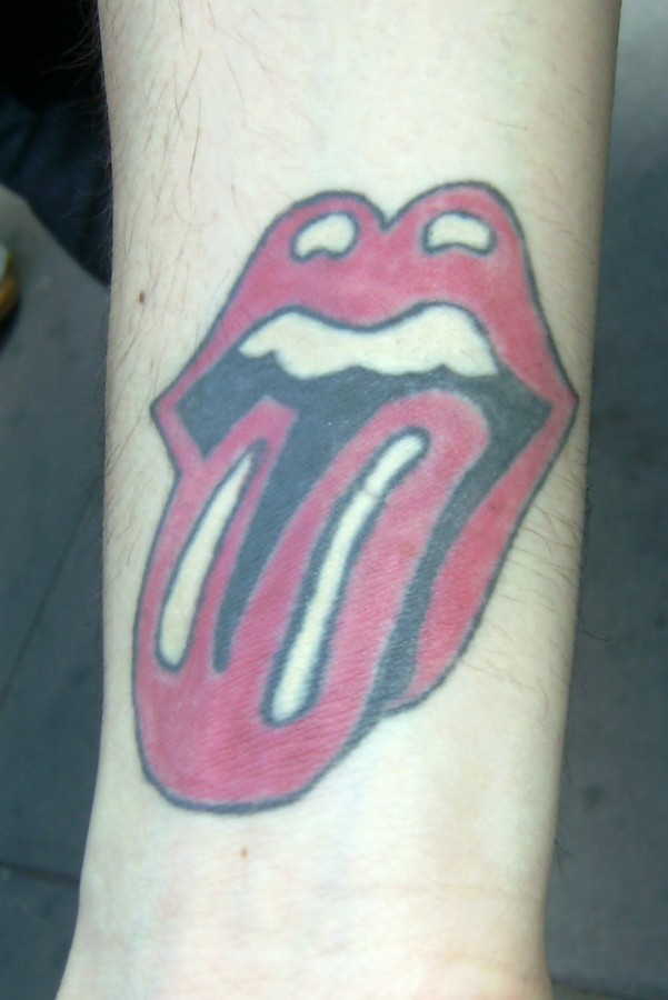 Simple rolling stones tattoo on arm