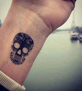 Skull black wrist tattoo