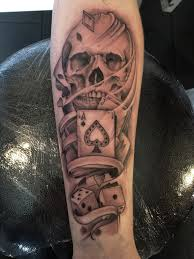 Skull with cards and dice tattoo
