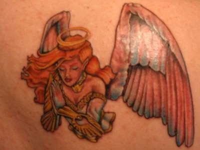 Small angel red haired tattoo