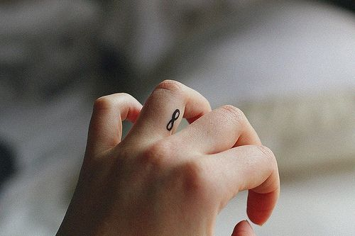 Small finger infinity tattoo