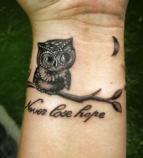 Small wrist owl tattoo