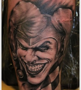 Smiling Joker black tattoo