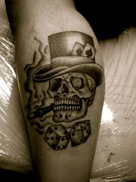 Smoking skull with dice tattoo
