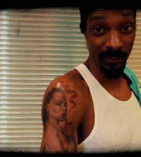 Snoop Dogg's right arm woman tattoo